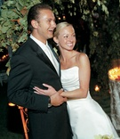 Newlyweds smiling in tuxedo and strapless gown