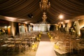 dimly lit ceremony space with gold and white details in the décor