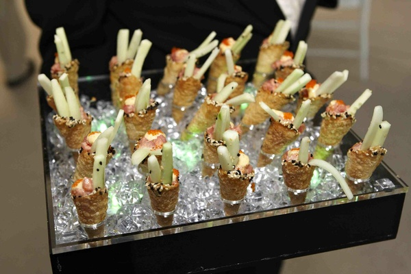 Cones of cucumber and spicy tuna on tray at wedding