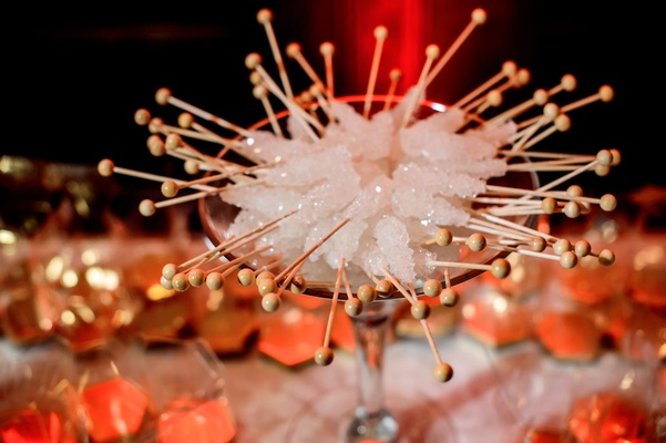 Wedding candy dessert bar with white rock candy on wood sticks wedding reception