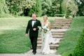 bride in v neck embroidery wedding dress veil blonde loose bouquet father in tuxedo stone steps