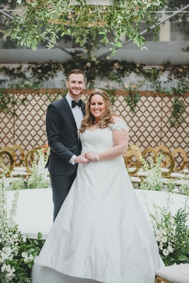 washington dc wedding couple bride in luxurious a line gown off shoulder sleeves groom in tuxedo