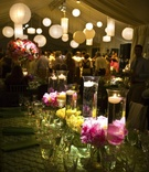 Floating candle and flower centerpiece tent wedding