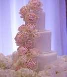White three tier wedding cake with beading, sugar flowers cascading down peony blush hydrangea