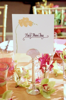 Wedding reception table card with a drawn orchid