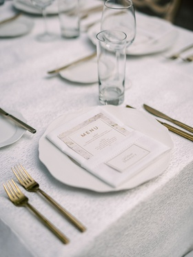 wedding reception place setting white charger gold fork knife flatware set gold white marble menu