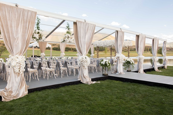 Aspen Colorado wedding ceremony outdoor open side tent clear roof drapery white flowers whitewash