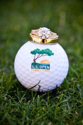 Round cut diamond engagement ring on Torrey Pines golf ball