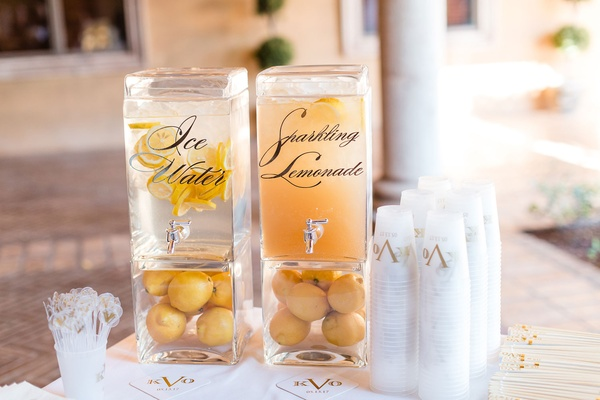 Monogram on plastic cups drink dispensers with calligraphy ice water and sparkling lemonade clear