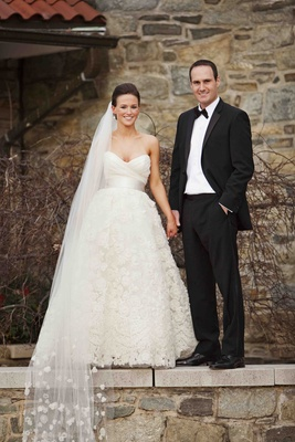 Man in tuxedo and woman in A-line bridal gown