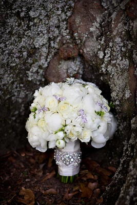 White peony and white rose bridal wedding bouquet with rhinestone dragonfly brooch accents