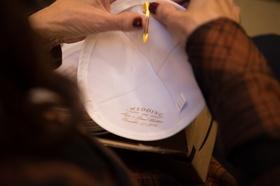 mother of the groom prepares clip on yarmulke