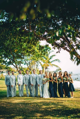 bridal party cool colors beach gray suits blue dresses punta mita destination wedding mexico