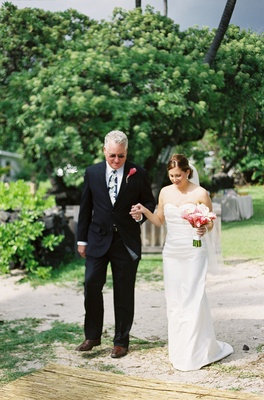 Laura Hooper and dad stepping on seagrass aisle