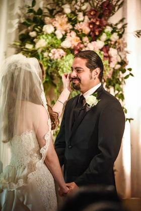 bride in oscar de la renta wipes tear of groom in tommy hilfiger hector maldonado from train