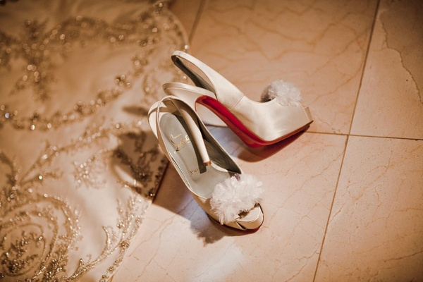 Christian Louboutin heels with ivory flowers