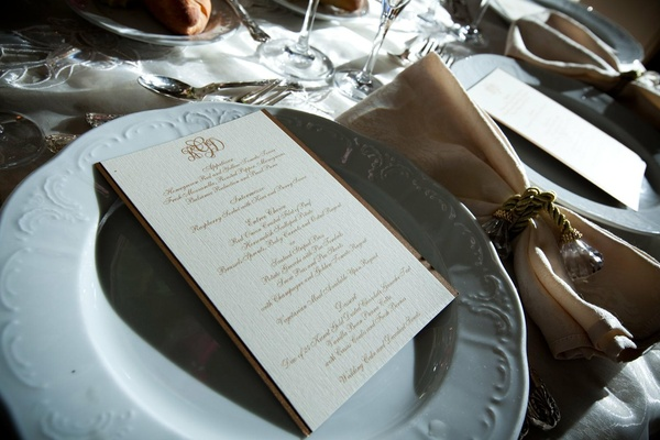 White texture charger plate with gold napkin ring