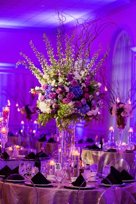 Wedding reception round table decor purple lighting clear ghost chair tall centerpiece purple flower