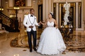 bride in ball gown illusion neckline headpiece groom in white tuxedo jacket bow tie shannon tahir
