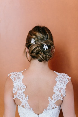 bridal floral hairpins from bhldn, lace straps on bridal gown