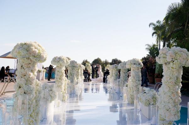 Joanna Krupa wedding ceremony aisle with flower columns