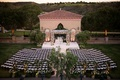Wedding ceremony full shot Grand Del mar flower chuppah with flower walls and initials