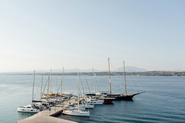 destination wedding in spetses greece, boats docked on the pier