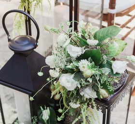 ceremony and reception were covered in white florals and lots of greenery