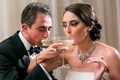 bride groom intertwine arms sip champagne wedding classic drink fun traditions big coupe glasses