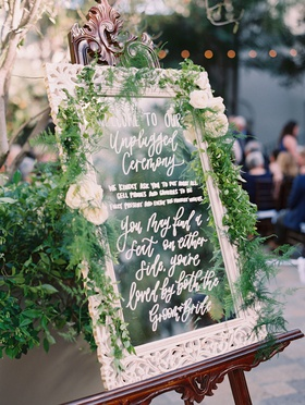 wedding ceremony outdoor vibiana white frame mirror greenery unplugged ceremony calligraphy signage