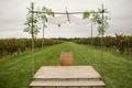 Wood stage with wine barrel vineyard wedding ceremony poplar tree chuppah jewish wedding handmade