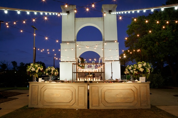 wedding bar with lights on waco suspension bridge over brazos river