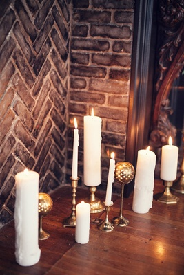Wedding ceremony in the grand ballroom of the Ebell Long Beach with candles in the fireplace