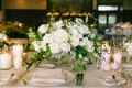 wedding reception white rose and garden rose centerpiece short with candles pillar votive linens