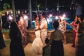 wedding guests hold sparklers in a circle around the dancing couple at reception