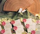 White place cards with green lettering and pink flowers