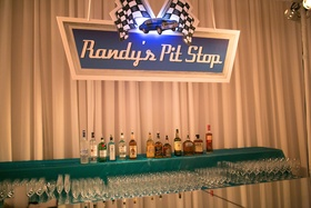 Men's bar area at wedding styled to look like Nascar