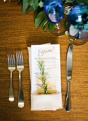 wood table at wedding reception royal blue glassware sprig of herb rosemary in napkin watercolor yum