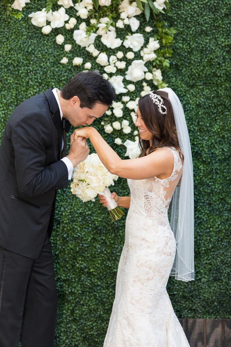Groom In Calvin Klein Kisses Hand Of Bride