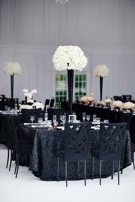 Black sequin wedding table with criss cross chairs