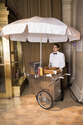 Silver cart with white umbrella for wedding guests pretzels