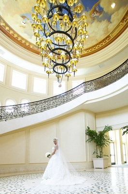 Dena Beber and wedding dress in ballroom