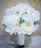 All white bridal bouquet with roses and ranunculus