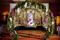 Wedding cake on swing greenery circle arch greenery purple flowers white flowers