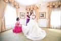 bride in alyne ball gown, mother of the bride in handmade peruvian gown