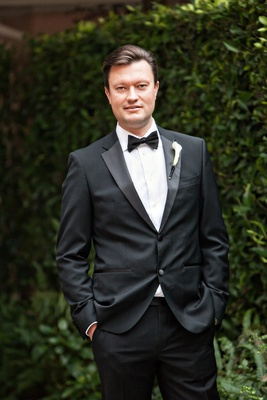 groom in hugo boss tuxedo with calla lily boutonniere