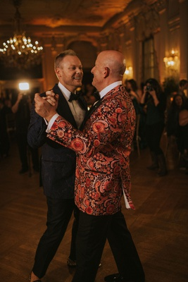 wedding reception gay lgbt same sex first dance rosecliff mansion newport rhode island floral tuxedo