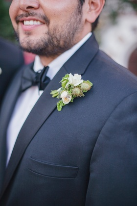 Groom wearing natural foliage on tuxedo lapel