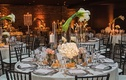 wedding reception brick wall round table calla lily flower centerpiece glass hurricane hydrangea