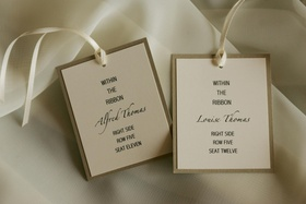 Ivory and white assigned seating cards